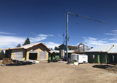 Crane over a custom built home during framing in Steamboat Springs