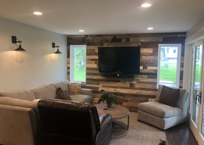 TV room with custom wall planking