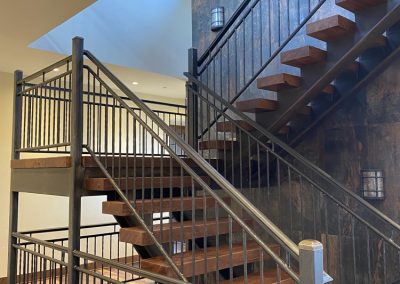 View of Stair case spanning three floors in custom build home in Steamboat Springs