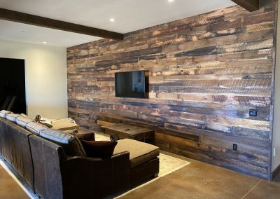 Custom built entertainment room with decorative wood