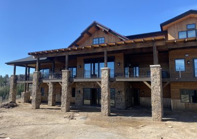 Residential custom built home that is two stories and has a wrap around deck