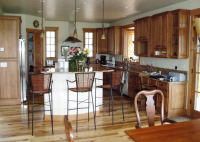 Residential kitchen with custom cabinets and island seating