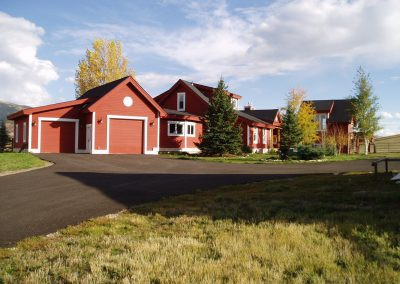 Red farm style custom built home in Steamboat Springs