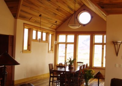Residential Dining room with vaulted ceilings and big windows