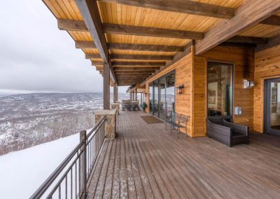Large open deck area with wood beam ceiling.