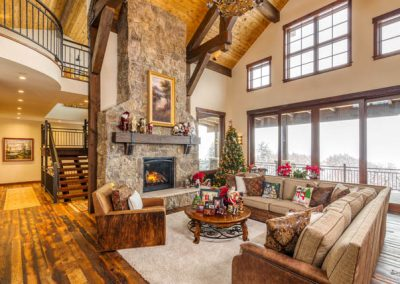 Large living room with two story tall fireplace.