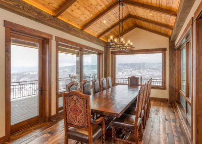 Dining room with vaulted ceilings.