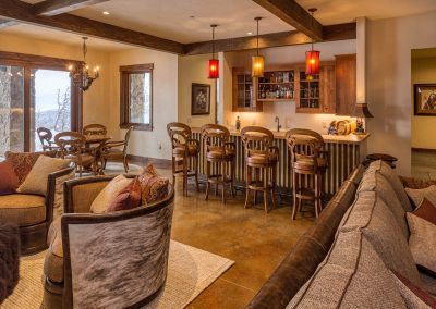 Bar area surrounded by living room and seating.