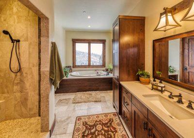 Large master bathroom with walk in shower and soaking tub.